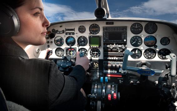 Businesswoman with plane